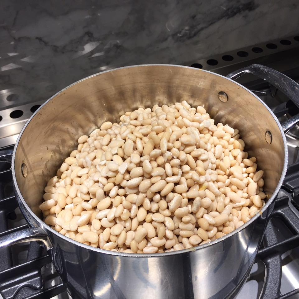The soaked white beans are now added to the pot and stirred with the base.